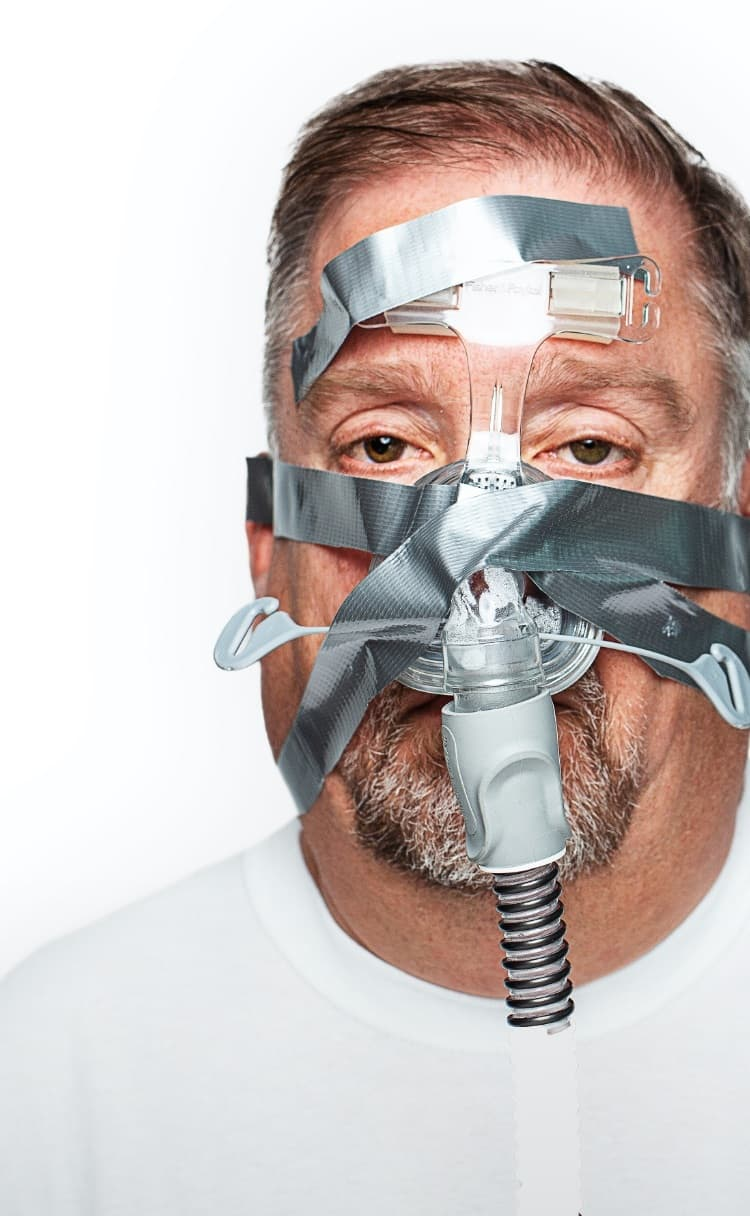 Man with CPAP mask taped on
