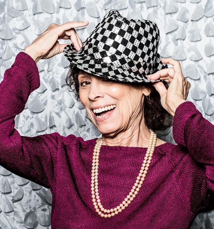 Woman wearing a hat at a jaunty angle